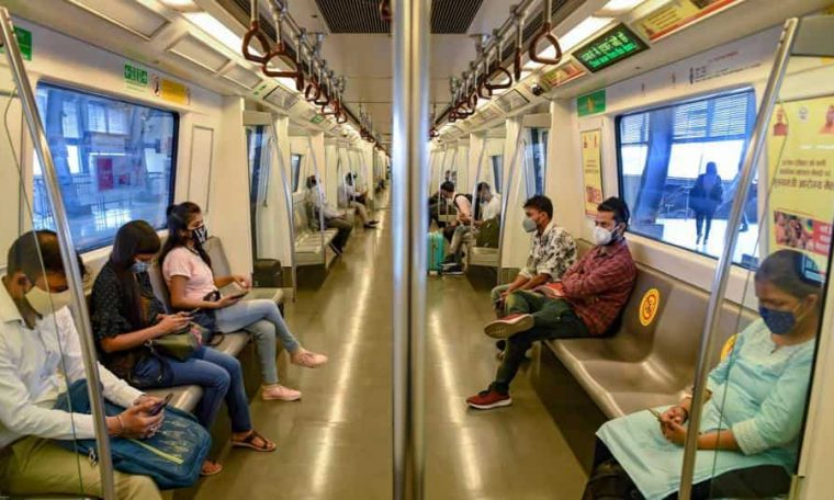 Commuters in a train after the Delhi Metro resumed services Monday.