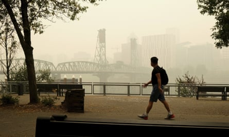 A pedestrian crosses the Willamette Bridge and Dr. Port Natown on Wednesday in Portland, Oregon.