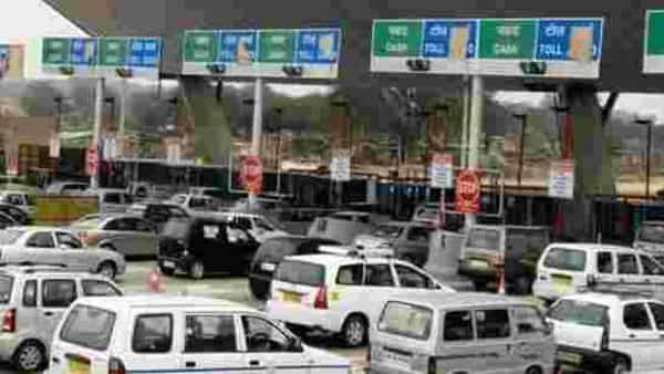 FASTag is an electronic toll collection device fixed on the windshield of a vehicle to enable drivers zip through toll plazas without having to stop. (Photo: Mint)
