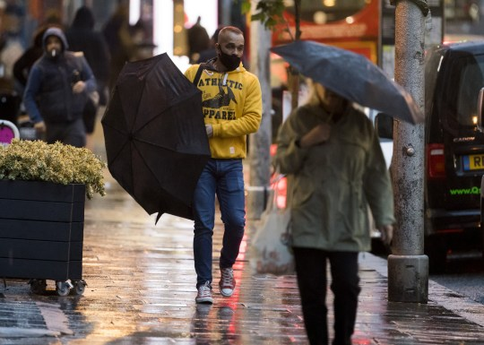 ?  London News Pictures licensed.  02/10/2020.  London, UK  During a morning trip to Ladbrook Grove in west London, heavy rain and wind brought members of the public fighting, such as Hurricane Alex, to 90 mph winds and heavy rain in large parts of the UK.  Photo credit: Ben Kathra / LNP