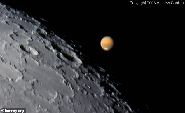 The combination will begin at 11:35 pm on Friday, October 2, with close access shortly after midnight.  The photo was taken in 2003.  A powerful telescope was able to take a close-up of a picture of the moon's surface and hang it on Tuesday.