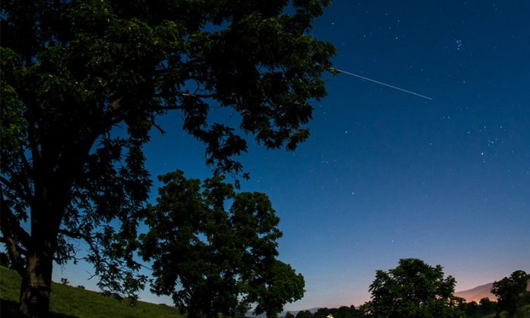 The International Space Station is seen in this 30 second exposure as it flies over Elkton, VA early in the morning, Saturday, August 1, 2015.