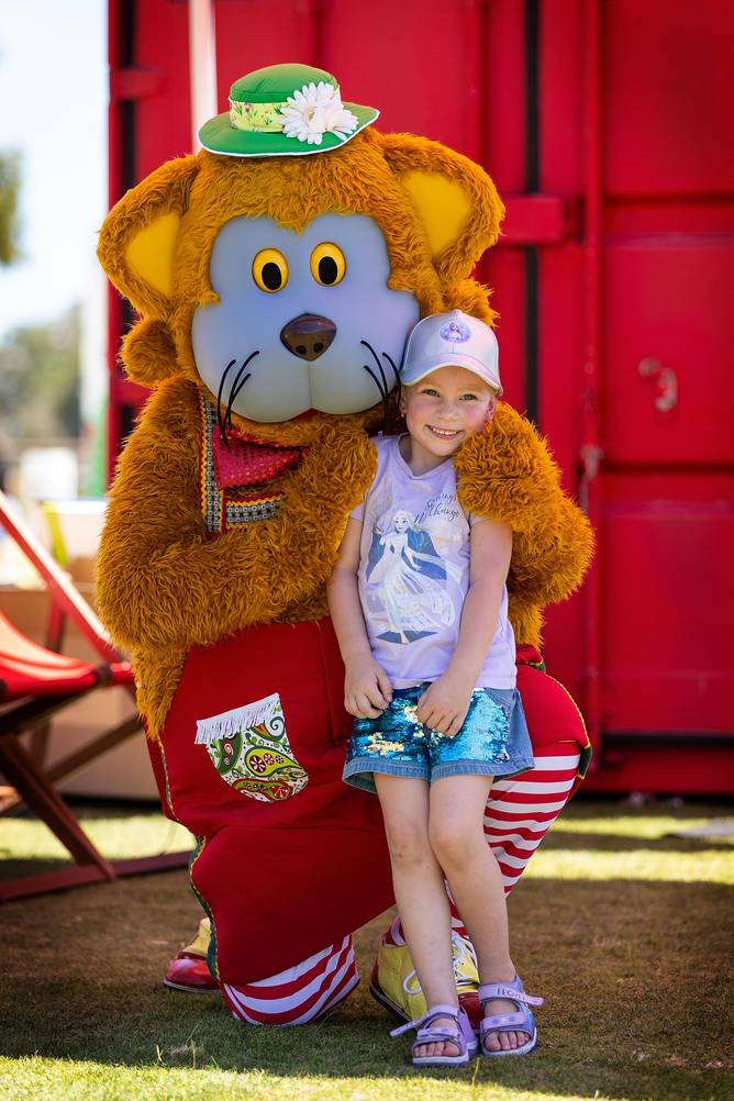 Four-year-old Willow Davis with Fat Cat at the Telithon Family Festival.