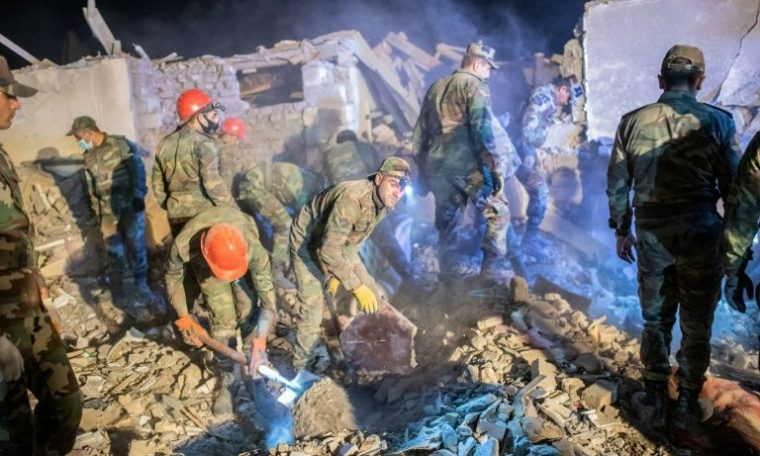 Rescue teams sift through rubble of a missile that struck the Azerbaijani city of Ganja