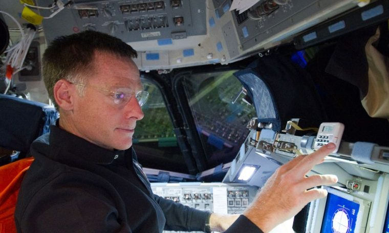 Astronaut chooses daughter's wedding over space flight