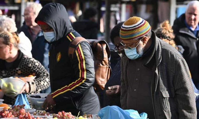 Shoppers wear facemasks at Leeds City Markets in Leeds, Yorkshire on October 31, 2020, as the number of cases of the novel coronavirus rises.