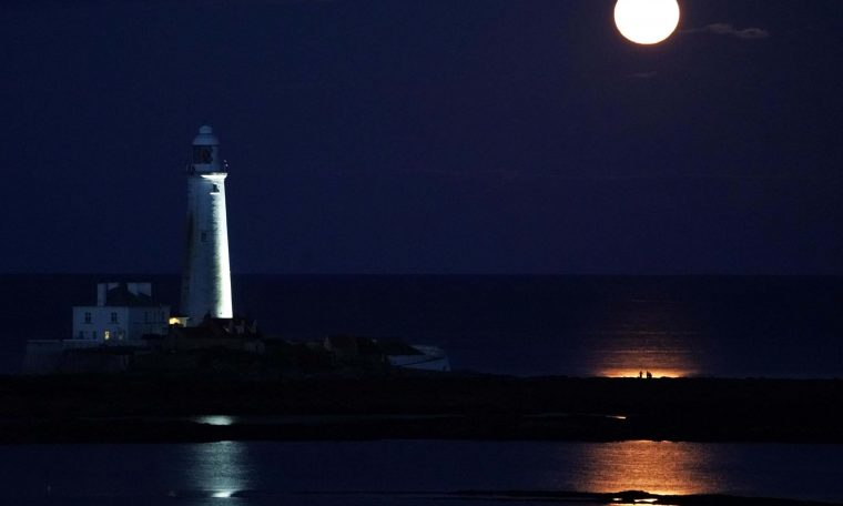 The August Full Moon, known as the Sturgeon Moon, rises above St Mary's Lighthouse in Whitley Bay