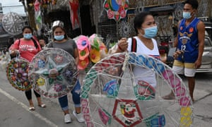 Customers flee with newly purchased lanterns for the festive season in San Fernando, Pampanga, Philippines