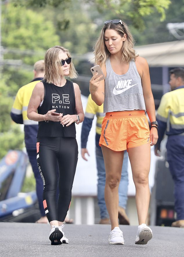 Like a mother, like a daughter!  Lindy looked as stylish as her model daughter in a PE nation top and black leggings