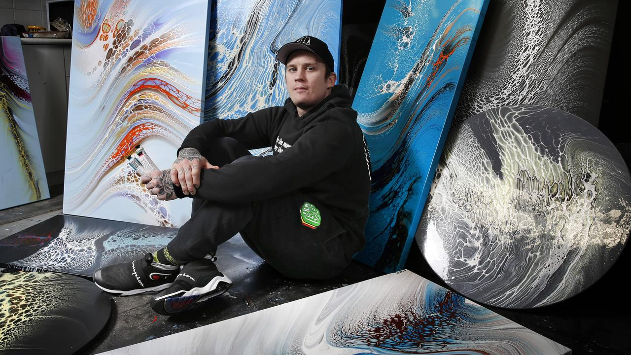 Dane Beams is surrounded by some of his art in his Health M Mind Art Studio.  Picture: David Caird