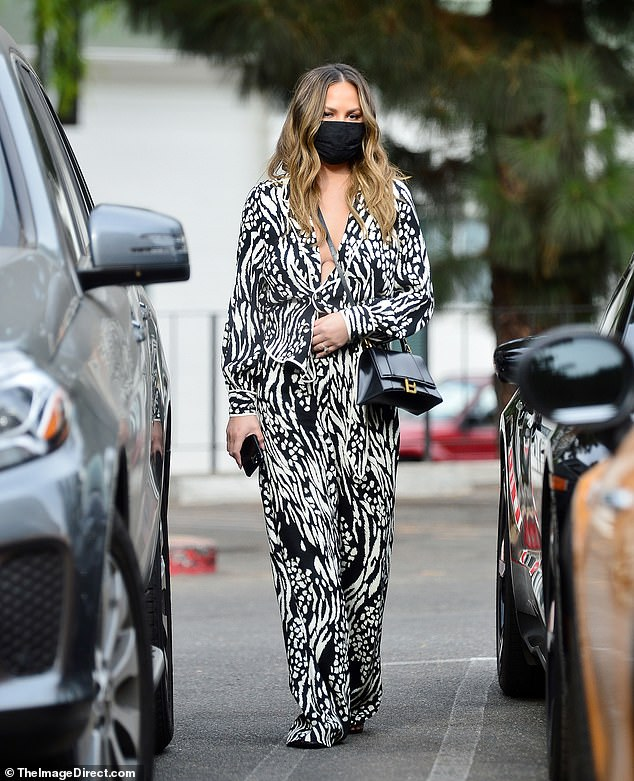 Arendz: Chrissy Tegin looked great when she wore a stylish blouse and pants set outside the LA on Thursday.