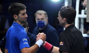 Novak Djokovic congratulates Dominic Theme at the end of his three-hour hard work