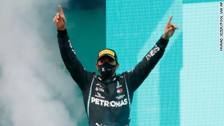Hamilton celebrates on the podium after winning the Turkish Grand Prix.