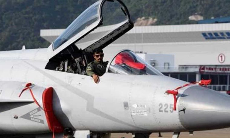 Pakistan Air Force personnel check a JF-17 Thunder fighter jet, which was featured in the movie.