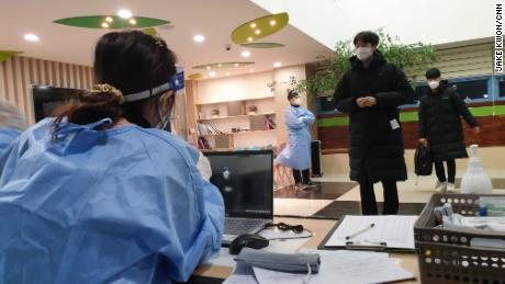 Students prepare to take their college entrance exam on December 3, 2020 at Dawson High School in Seoul, South Korea with special coronavirus precautions.