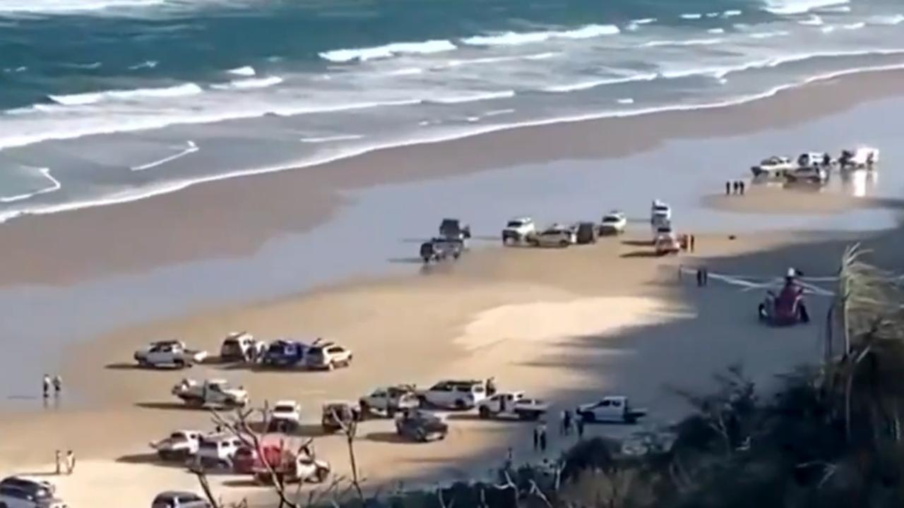 Two people have died after being pulled from a surfboard on a Queensland beach.  Picture: 7 News