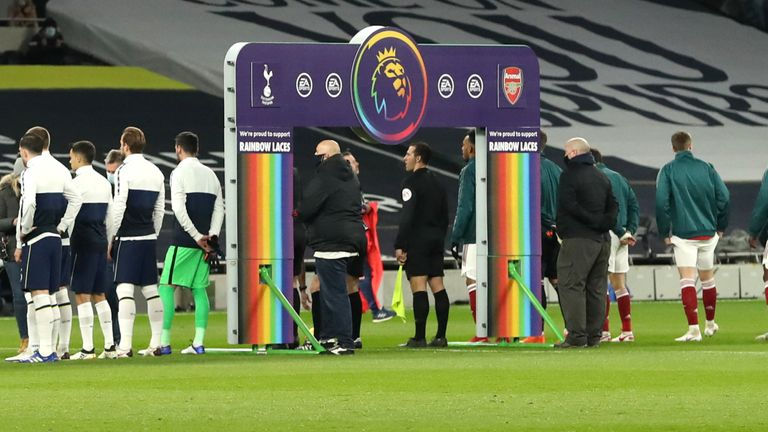 LONDON, England - December 6: Both sets of players stand in front of a handshake board with Stonewall Rainbow Lace branding in support of their campaign ahead of the Premier League match between Tottenham Hotspur and Arsenal at Tottenham Hotspur Stadium.  December 06, 2020 in London, England.