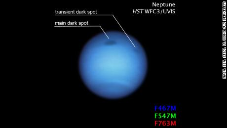 The small dark spot in this Hubble figure may be a fragment of a giant storm that broke as it approached the larger rotating equator.