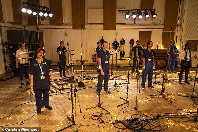 Tifful Nfull: The choir recorded a new song at London's iconic Abbey Road studio, in which Justin said: Let's share.  '