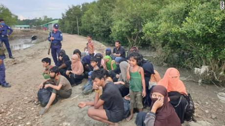 Dozens of refugees stranded at sea to be separated on the disputed island