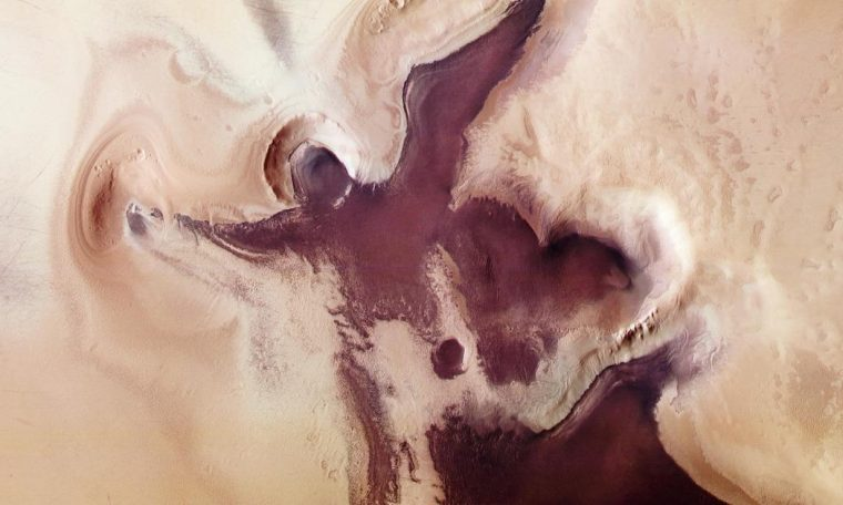"Before Christmas, Mars marks an ""Angelic figure"" near the South Pole."