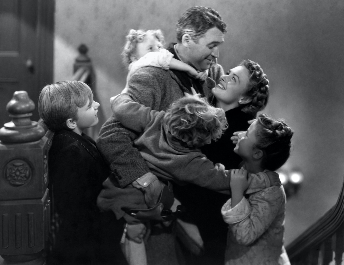 James Stewart, Donna Reed, Carol Coombs, Jimmy Hawkins, Larry Sims and Caroline Grimes in 'It's a Wonderful Life'