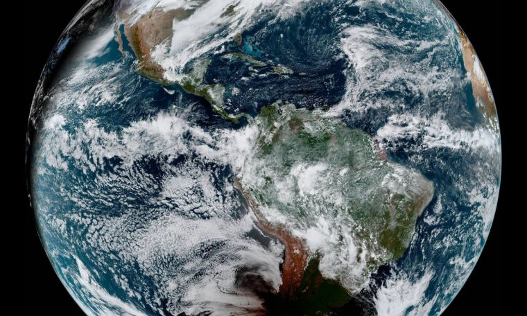 See the moon's shadow on Earth from the total solar eclipse of 2020 in these amazing satellite views.