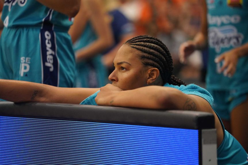Liz Cambez sits on the bench during the WNBL's spectacular final between the Southside Flyers and the Townsville Fire.