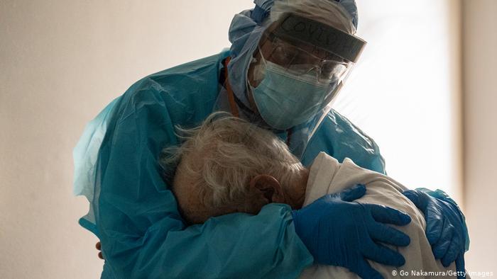 Doctors console elderly patients