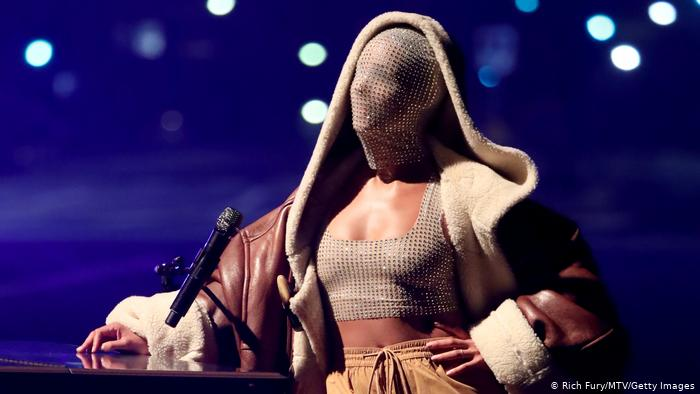In one performance, singer Alicia Keys covers her entire face like a semi-transparent sock.