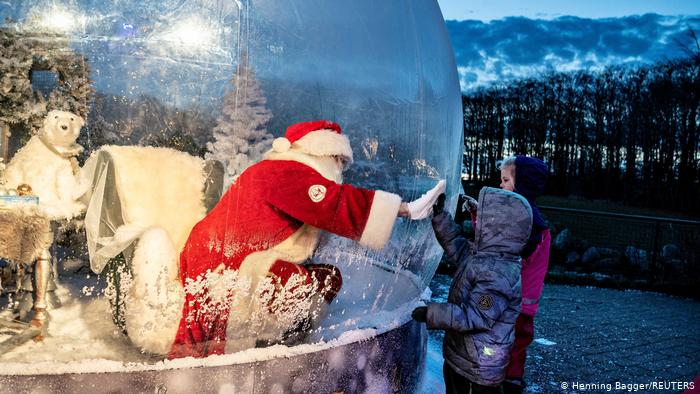 Santa Claus makes children stand outside in a plastic bubble