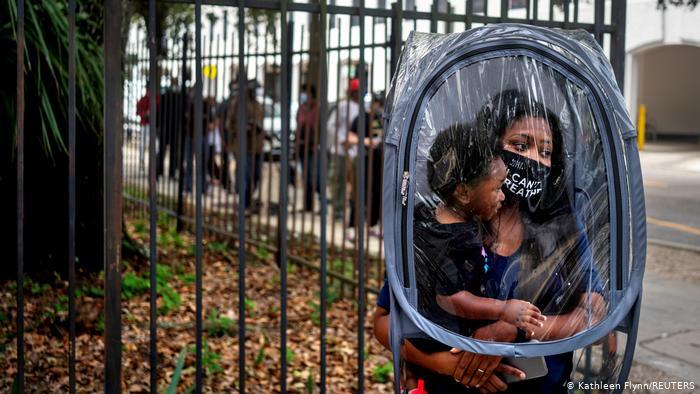 Women and children inside plastic bubble