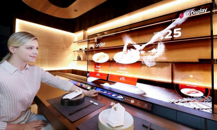 LG Sushi displays with its transparent OLED screen in bar and metro window
