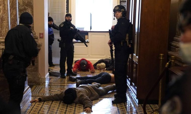 Legislative Police Arrests a Group of Donald Trump Supporters Attacking Congress Photo: Drew Anger / AFP