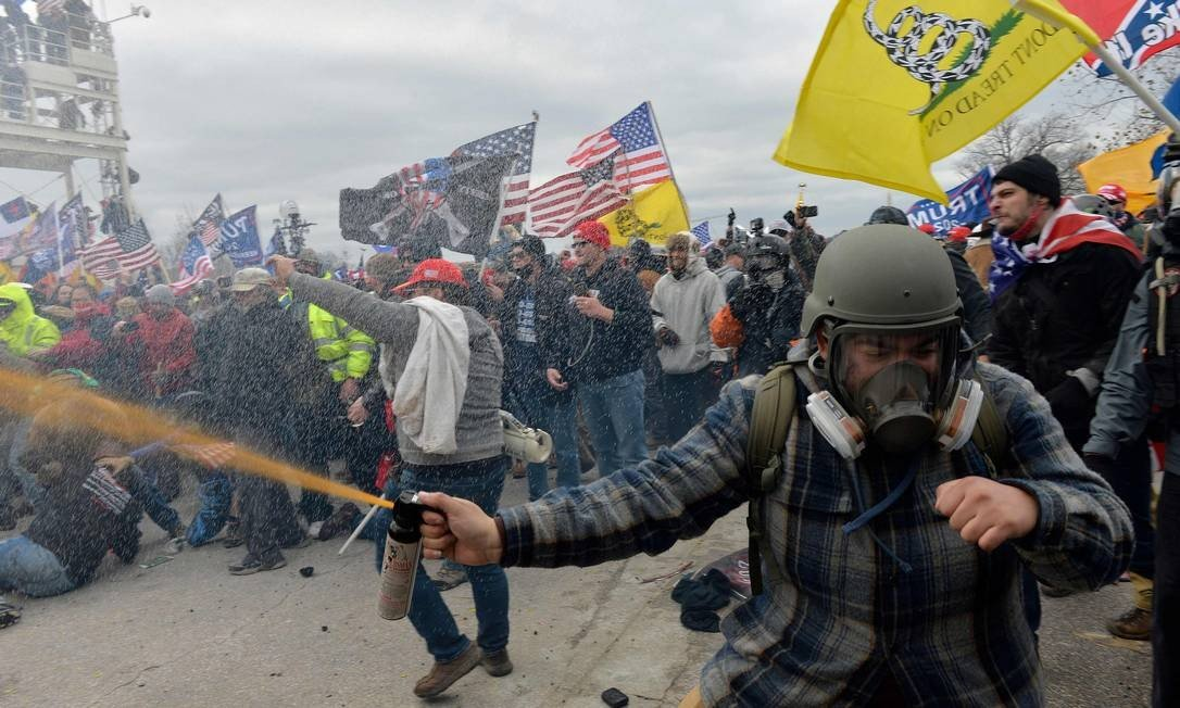 Pro-Trump protesters clash with police and security forces as they attempt to invade the US Congress Photo: Joseph Prezio / AFP