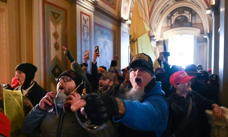 Off-duty police officers investigated for participating in the US Capitol invasion, the newspaper says.  world