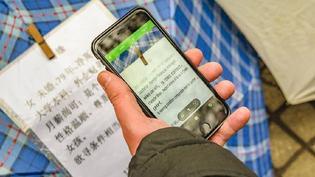 SHANGHAI, China, DECEMBER - 2018 - People are using Google Translate to read Chinese characters Category, Shanghai, China