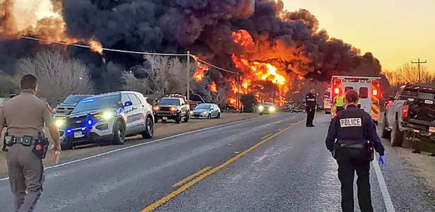 Gasoline carrying train collides with truck and causes explosion