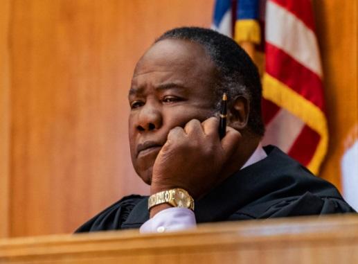 In the film, Isha Hwatlock Jr. is the judge Lomax
