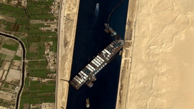 Satellite image shows ship stranded in channel