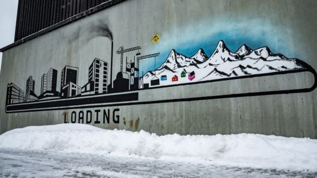 New graffiti depicts buildings and chimneys instead of the island's natural landscape