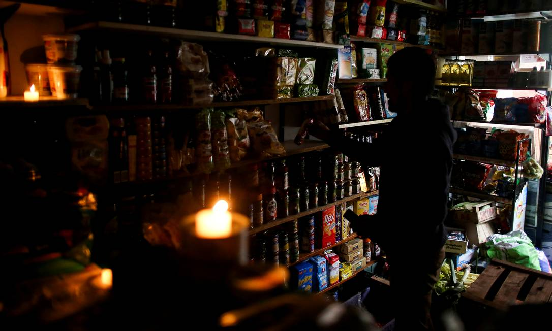 Salesman works at his store during a national blackout in Buenos Aires in June 2019: Frustrations with governments have prompted a new exodus of Argentina out of the country Photo: Agustin Maserian / Reuters