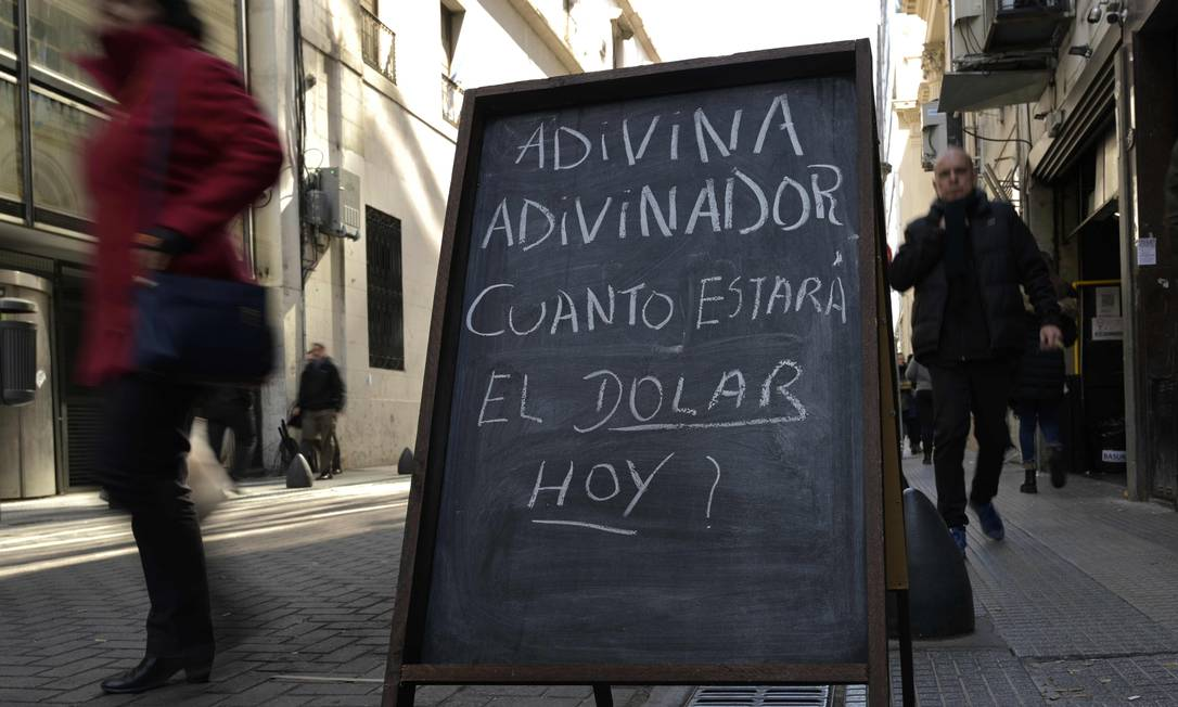 Photo about the devaluation of the Argentine currency (peso) at the financial center of Buenos Aires