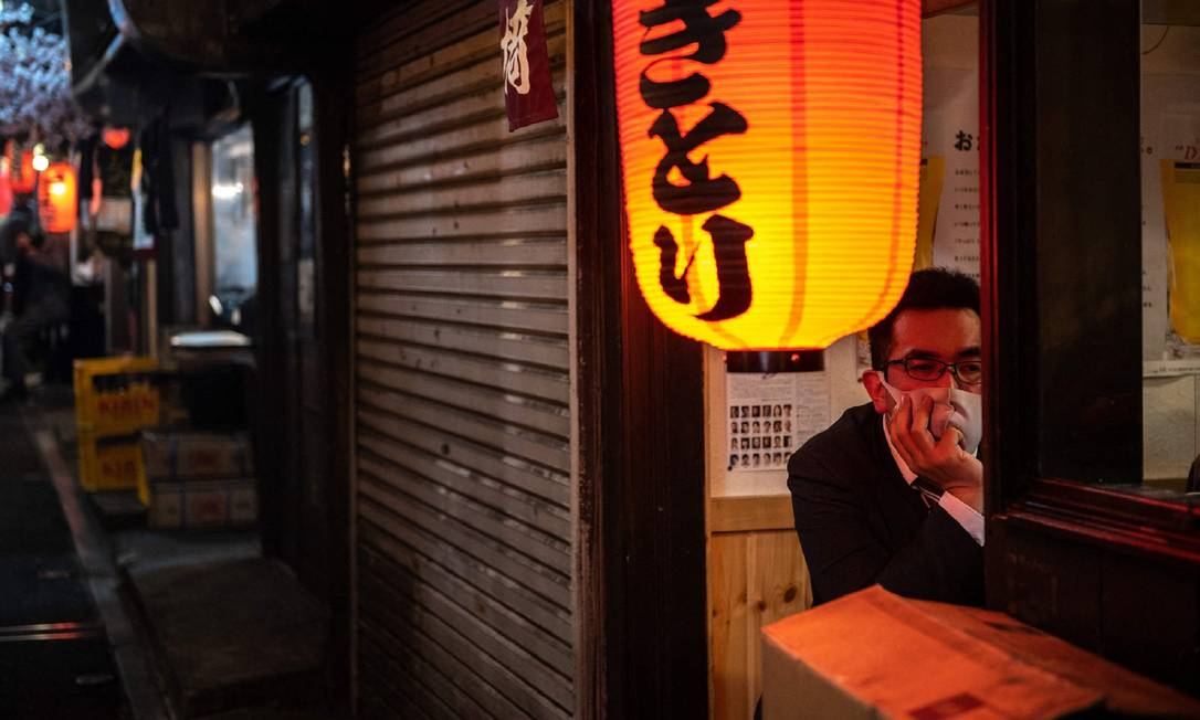 Man sitting in a restaurant by the side of Omoid Yokocho street in Tokyo's Shinjuku district Photo: Philip Fong / AFP