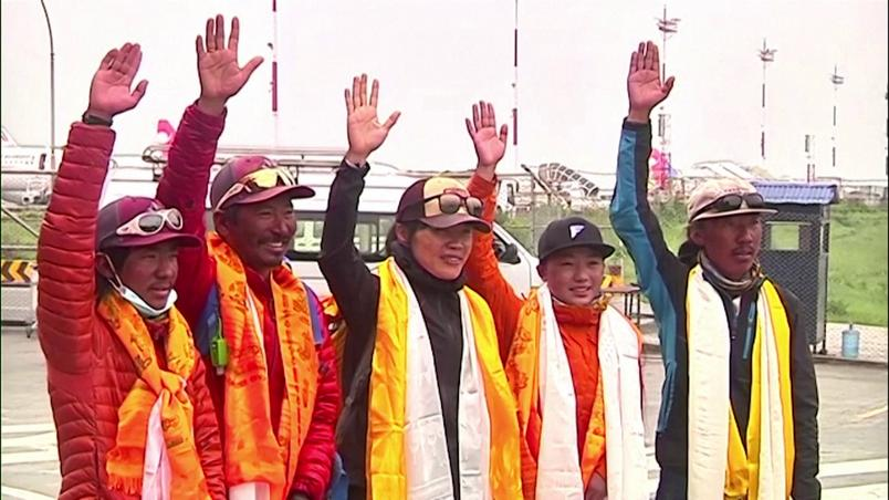 Tsang Yin-hung (C) became the fastest woman to climb Everest