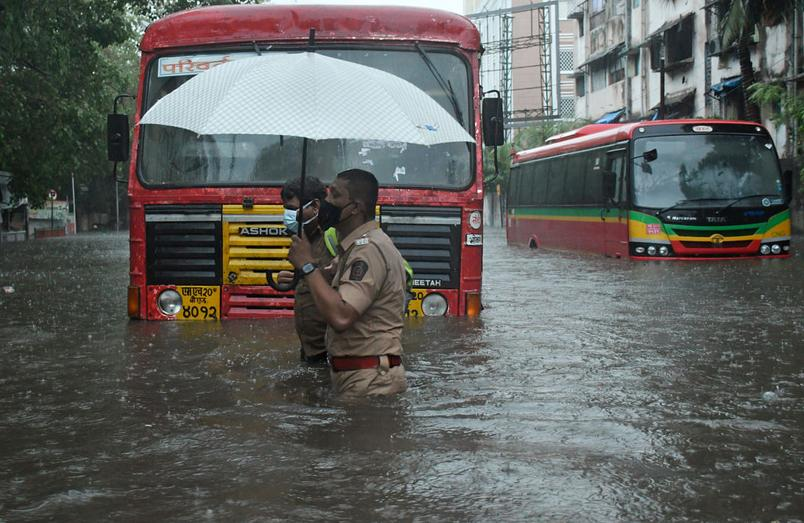 Police officers on submerged streets of Mumbai