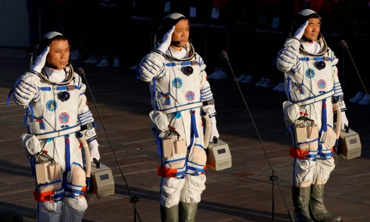 Ni Haisheng, Liu Boming and Tang Hongbo join the Chinese mission to the new space station Photo: Carlos Garcia Rollins / Reuters