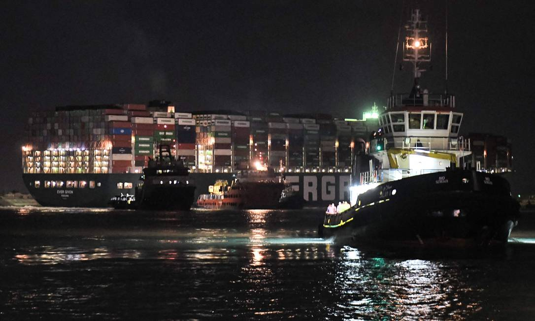 Tugboats worked to land the giant Ever Given Photo on Saturday night: Ahmed Hassan / AFP