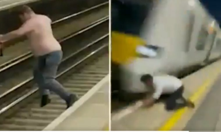 VIDEO: Drunk jumping on a London rail track shortly before a train passes.  world