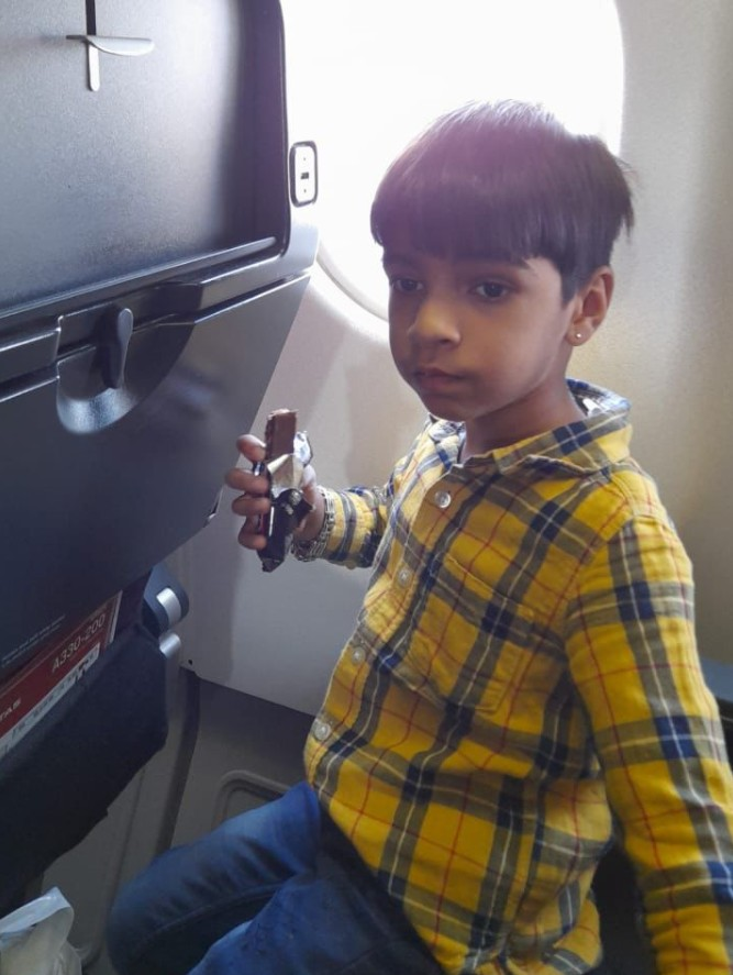Nivan on a flight back to Australia after being separated from his mother for two years (Photo: Personal Archive)